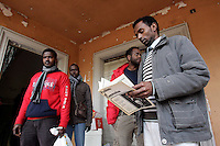 Rifugiati somali nell'ex ambasciata di Somalia a Roma, 29 dicembre 2010..Circa 200 rifugiati somali vivono in condizioni igieniche precarie nell'edificio che ospitava l'ambasciata e che e' stato abbandonato dopo la caduta del governo somalo negli anni Novanta..Somalian refugees stand inside the former Somalian embassy in Rome, 29 december 2010. About 200 refugees live  in precarious hygienic conditions in the building, which is still the property of the Somali government but was abandoned after the collapse of the government in Mogadishu in the 1990s..© UPDATE IMAGES PRESS/UPDATE IMAGES PRESS/Riccardo De Luca