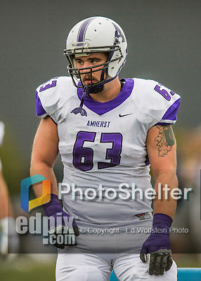 8 October 2016: Amherst College Purple & White Offensive Lineman Kevin Sheehan, a Junior from Medway, MA, is attentive to coaching on the sidelines during a game against the Middlebury College Panthers at Alumni Stadium in Middlebury, Vermont. The Panthers edged out the Purple & While 27-26. Mandatory Credit: Ed Wolfstein Photo *** RAW (NEF) Image File Available ***