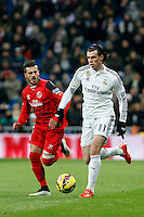 Gareth Bale of Real Madrid and Diogo of Sevilla during La Liga match between Real Madrid and Sevilla at Santiago Bernabeu Stadium in Madrid, Spain. February 04, 2015. (ALTERPHOTOS/Caro Marin) /NORTEphoto.com