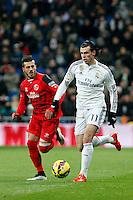 Gareth Bale of Real Madrid and Diogo of Sevilla during La Liga match between Real Madrid and Sevilla at Santiago Bernabeu Stadium in Madrid, Spain. February 04, 2015. (ALTERPHOTOS/Caro Marin) /NORTEphoto.com