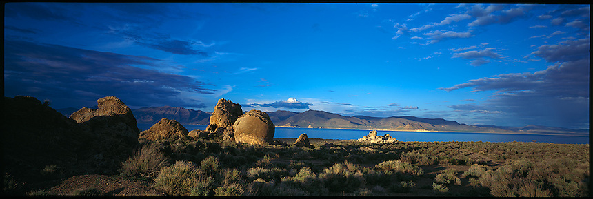 Pyramid Lake covers 125,000 acres, making it one of the largest natural lakes in the state of Nevada. Pyramid Lake is also the biggest remnant of ancient Lake Lahontan, the colossal inland sea that once covered most of Nevada. The scenery is spectacular, and the color of Pyramid Lake changes from shades of blue or gray, depending on the skies above. Pyramid Lake is also surrounded by unusual rock formations, including the Stone Mother. Pyramid Lake's significant role in the history of the Paiute Indian tribe also adds to its mystique and many myths and tales surrounding it. Today, Pyramid Lake is part of the National Scenic Byways Program and the only byway in the country located entirely within a tribal reservation.