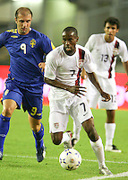 DaMarcus Beasley dribbles the ball ahead of Kennedy Bakirci. Sweden defeated the USA, 1-0, in an international friendly in Gothenburg, Sweden on August 22, 2007.