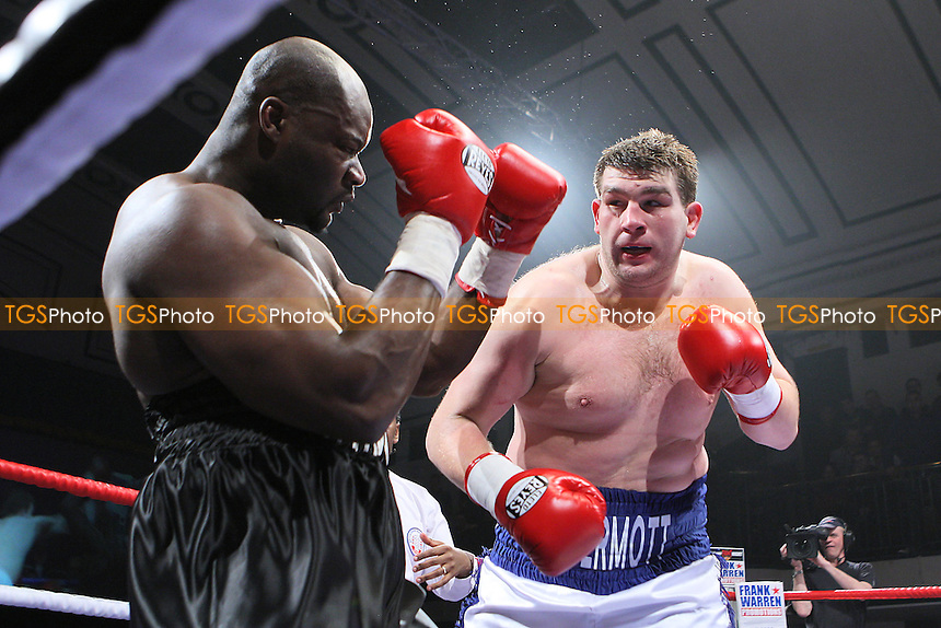 John McDermott (white/blue shorts) defeats Larry Olubamiwo in a Heavyweight boxing contest for the Southern Area Title at York Hall, Bethnal Green, London, promoted by Frank Warren - 19/02/11 - MANDATORY CREDIT: Gavin Ellis/TGSPHOTO - Self billing applies where appropriate - Tel: 0845 094 6026