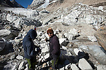 Dr Shresth Tayal, Glaciologist at The Energy and Resources Institute (TERI) with his assistant Nathaniel Dkhar (left), recovers a measuring rod that was previously covered in ice  at the fast reducing Rathong Glacier (at top left of frame) below the 6678 meter Rathong Peak in the North East Indian state of Sikkim close to the Nepalese border. Considered to be a themometre of the environment, it has been chosen by TERI to be a test case of environmental damage being done in India and China. Dr. Tayal is conducting three dimensional tests that include measuring the depth of the ice to form concrete conclusions on the fate of the glacier.The Indian Government is denying the glaciers' demise despite data suggesting it has been reduced by more than over 80% in the last 42 years.