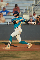 Kye Andress (6) (Catawba Valley CC) of the Mooresville Spinners follows through on his swing against the Dry Pond Blue Sox at Moor Park on July 2, 2020 in Mooresville, NC.  The Spinners defeated the Blue Sox 9-4. (Brian Westerholt/Four Seam Images)
