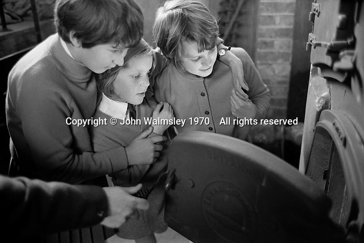 Looking in the school boiler, Whitworth Comprehensive School, Whitworth, Lancashire.  1970.