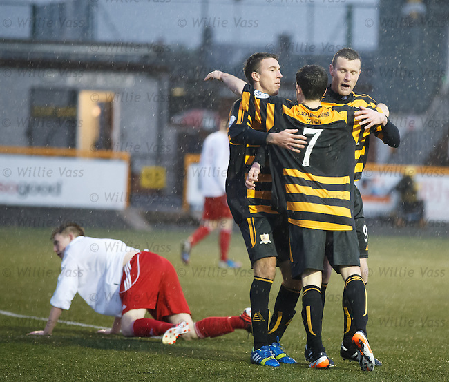 Goalscorer Kevin Cawley is congratulated by Alloa team mates Eddie Ferns and Andy kirk