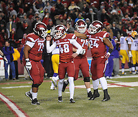 NWA Media/ANDY SHUPE - Arkansas' Adam McFain (48) is congratulated by Sebastian Tretola (73) after kicking a field goal against LSU's during the first quarter Saturday, Nov. 15, 2014, at Razorback Stadium in Fayetteville.