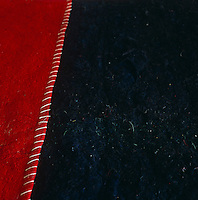 Used in Morocco for making hats, these metre squares of red and blue-black felt have been sewn together to create a striking bedcover