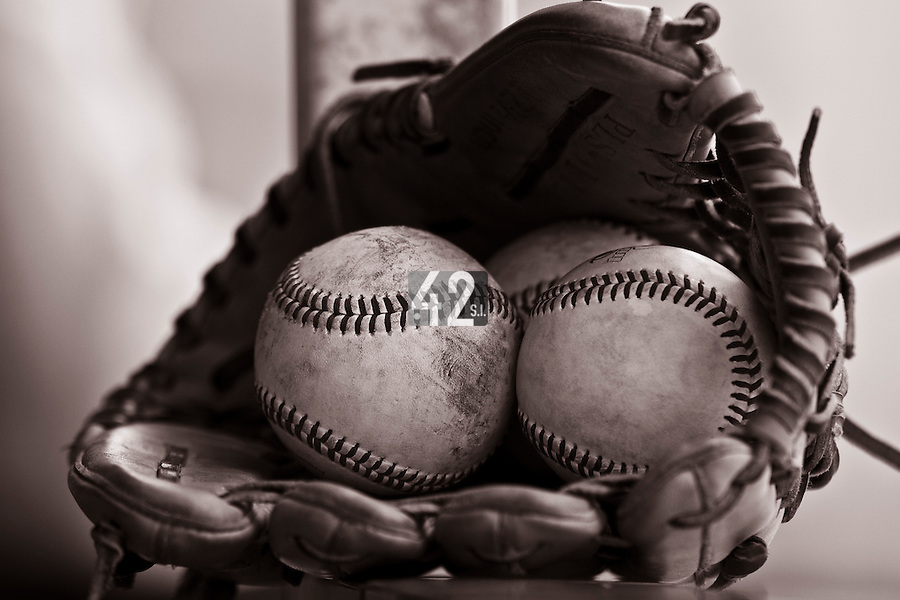 21 May 2009: A glove and three balls are seen in the dugout during the 2009 challenge de France, a tournament with the best French baseball teams - all eight elite league clubs - to determine a spot in the European Cup next year, at Montpellier, France.