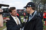 2013 March 02: Head coach John Tillman Maryland Terrapins speaks with ESPN's Quint Kessenich during a game against the Duke Blue Devils at Koskinen Stadium in Durham, NC.  Maryland won 16-7.