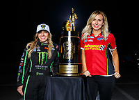 Nov 12, 2017; Pomona, CA, USA; NHRA top fuel driver Brittany Force (left) poses for a portrait with her sister Courtney Force as she celebrates after winning the 2017 top fuel world championship and the Auto Club Finals at Auto Club Raceway at Pomona. Mandatory Credit: Mark J. Rebilas-USA TODAY Sports