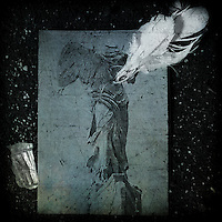 Postcard of headless stone angel, with white feather, broken object and texture applied.