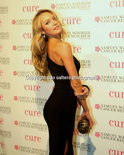 Victoria Secret Model Candice Swanepoel attends the 12th Annual Collaborating For a Cure Dinner & Auction to benefit the Samuel Waxman Cancer Research Foundation at the Park Avenue Armory, November 18, 2009 .