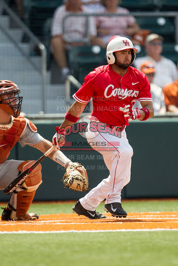 Houston Cougars shortstop Frankie Ratcliff (7) follows through on his swing during the NCAA baseball game against the Texas Longhorns on June 6, 2014 at UFCU Disch–Falk Field in Austin, Texas. The Longhorns defeated the Cougars 4-2 in Game 1 of the NCAA Super Regional. (Andrew Woolley/Four Seam Images)