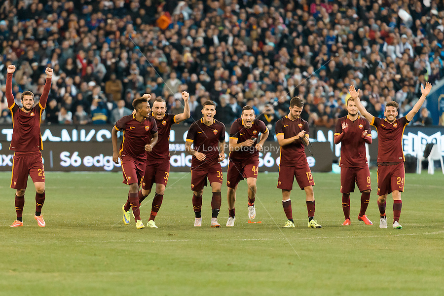 Melbourne, 18 July 2015 - Roma players celebrate their win in game one of the International Champions Cup match at the Melbourne Cricket Ground, Australia. Roma def Real Madrid 7-6 Penalties. Photo Sydney Low/AsteriskImages.com