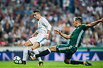 Cristiano Ronaldo (r) of Real Madrid is tackled by Zouhair Feddal Agharbi of Real Betis during the La Liga 2017-18 match between Real Madrid and Real Betis at Estadio Santiago Bernabeu on 20 September 2017 in Madrid, Spain. Photo by Diego Gonzalez / Power Sport Images