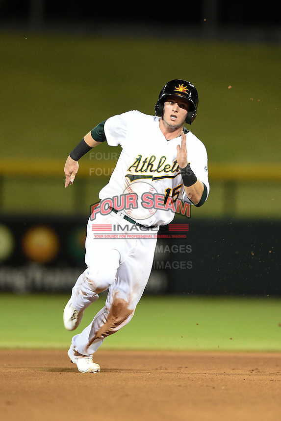 Mesa Solar Sox infielder Daniel Robertson (15) during an Arizona Fall League game against the Surprise Saguaros on October 10, 2014 at Cubs Park in Mesa, Arizona.  Surprise defeated Mesa 14-3.  (Mike Janes/Four Seam Images)