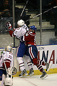 March 15, 2009:  Center Stefan Meyer (10) of the Rochester Amerks, AHL affiliate of Florida Panthers, checks Alex Henry (5) during the third period of a regular season game at the Blue Cross Arena in Rochester, NY.  Hamilton defeated Rochester 4-3 in a shoot out.  Photo Copyright Mike Janes Photography 2009