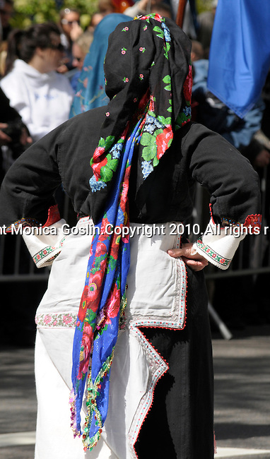 Greek Parade in New York City. A woman in traditional clothing walks in the Greek Parade in New York City.
