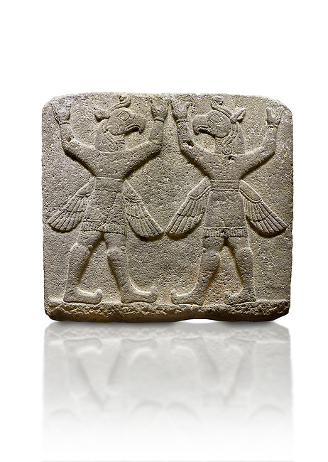 """Picture & image of Hittite relief sculpted orthostat stone panel of Herald's Wall Basalt, Karkamıs, (Kargamıs), Carchemish (Karkemish), 900-700 B.C. Bird-headed, winged figures of human body. Anatolian Civilisations Museum, Ankara, Turkey.<br /> <br /> These figures are called as """"Winged Griffin Demons"""". Embossing is constructed symmetrically. Their hands are on their heads. It is assumed that they carry the heavens. <br /> <br /> Against a white background."""