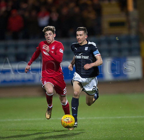 8th December 2017, Dens Park, Dundee, Scotland; Scottish Premier League football, Dundee versus Aberdeen; Dundee's Cammy Kerr and Aberdeen's Ryan Christie chase towards the byeline