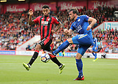 30th September 2017, Vitality Stadium, Bournemouth, England; EPL Premier League football, Bournemouth versus Leicester; Christian Fuchs of Leicester attempts to clear the ball, as Joshua King of Bournemouth puts in a block