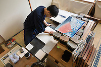 Printer Yoshio Kyoso works on a reproduction of Katsushika Hokusai's Fine Wind, Clear Morning. Adachi Foundation for the Preservation of Woodcut Printing, Tokyo, Japan, July 15, 2014. The Foundation works to preserve the original techniques of Japanese woodblock printing. As well as recreating classic ukiyo-e from the Edo period, they train and employ young artisans, and also educate about the art form.