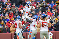 Landover, MD - December 9, 2018: New York Giants running back Saquon Barkley (26) celebrates a 78 yard touchdown late in the first quarter of game between the New York Giants and Washington Redskins at FedEx Field in Landover, MD. The Giants defeated the Redskins 40-16 dropping the Redskins to 6-7 on the season. (Photo by Phillip Peters/Media Images International)