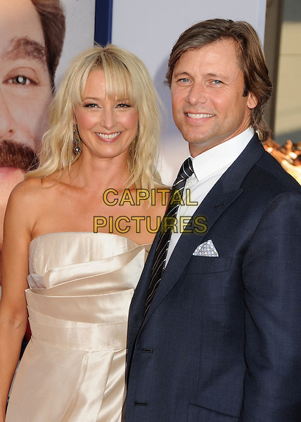 "Katherine LaNasa, Grant Show.""The Campaign"" Los Angeles Premiere held at Grauman's Chinese Theatre, Hollywood, California, USA..August 2nd, 2012.half length suit strapless dress clutch bag couple white shirt black suit silver  .CAP/ADM/BP.©Byron Purvis/AdMedia/Capital Pictures."