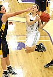 SIOUX FALLS, SD - JANUARY 2:  Marie Malloy #4 from the University of Sioux Falls lays the ball up around Naomi Rust #42 from Augustana in the second half of their game Friday night at the Stewart Center. (Photo by Dave Eggen/Inertia)