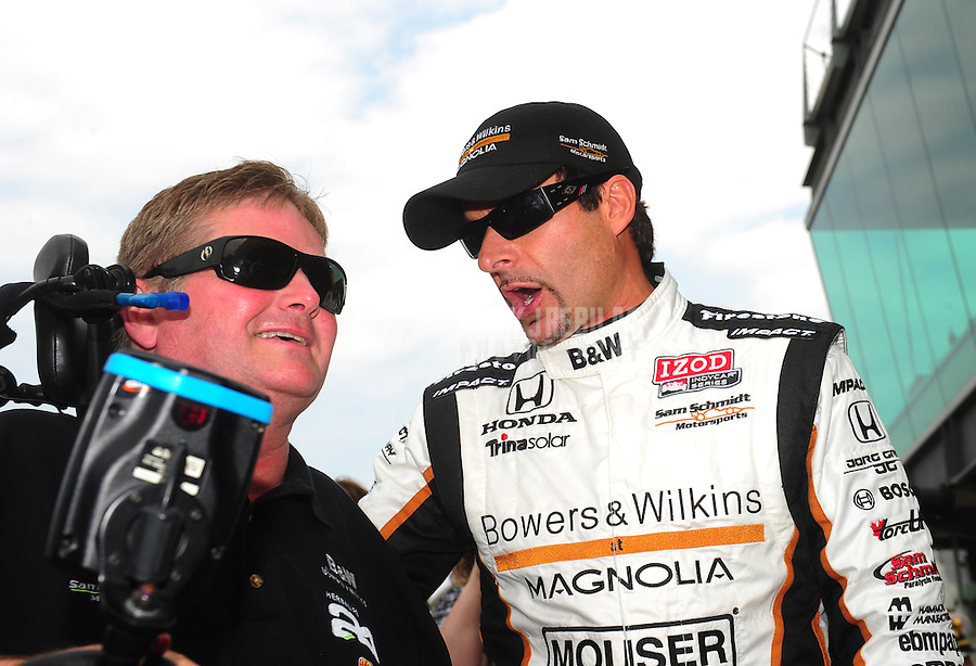 May 29, 2011; Indianapolis, IN, USA; Indy Car Series driver Alex Tagliani (right) with team owner Sam Schmidt during the 95th running of the Indianapolis 500 at the Indianapolis Motor Speedway. Mandatory Credit: Mark J. Rebilas-