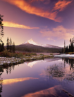 Mount Washington and Big Lake with snow and sunset. Oregon.