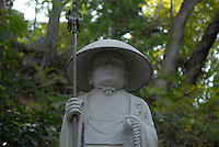 A statue of Kobo Daishi on the approach to Yakuouin temple. Kobo Daishi is the founder of the Shingon religion.