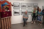 Martin Parr photographer (sitting) at the Martin Parr Foundation MPF  gallery Bristol. Exhibition work by Marketa Luskacova 2010s 2019