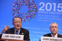 Washington, DC - April 16, 2015: World Bank President Jim Yong Kim (left) holds a press availability April 16, 2015 at the International Monetary Fund Headquarters in the District of Columbia during the annual Spring Meeting of the World Bank Group/IMF. John Donnelly, seated right, serves as Communications Advisor to Kim. (Photo by Don Baxter/Media Images International)