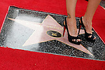 "US actress Kyra Sedgwick is seen standing on her star after she received the 2,384th Star on the Hollywood Walk of Fame, Los Angeles, California, USA, on June  8, 2009. Kyra Sedgwick was born in New York in 1965 and grew up in Manhattan.  She made her professional acting debut at the age of 16 on the soap opera ""Another World."" .Photo by Nina Prommer/Milestone Photo"