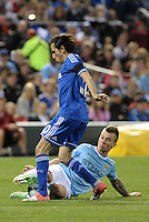Albert Rusnak (55) Manchester City tackles Yossi Benayoun (30) Chelsea .Manchester City defeated Chelsea 4-3 in an international friendly at Busch Stadium, St Louis, Missouri.