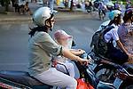 Woman & Young Boy On Scooter