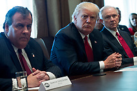 US President Donald J. Trump (C), with New Jersey Governor Chris Christie (L), Attorney General Jeff Sessions (R),delivers remarks during an opioid and drug abuse listening session in the Roosevelt Room of the White House in Washington, DC, USA, 29 March 2017. Photo Credit: Shawn Thew/CNP/AdMedia