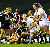 Rugby Union. Twickenham, England. Claire Richardson of New Zealand Black Ferns tackled during the QBE international match between England and New Zealand Black Ferns at Twickenham Stadium on December 01, 2012 in Twickenham, England.