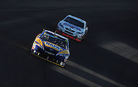 Mar 2, 2008; Las Vegas, NV, USA; NASCAR Sprint Cup Series driver Michael Waltrip leads Mike Skinner during the UAW Dodge 400 at Las Vegas Motor Speedway. Mandatory Credit: Mark J. Rebilas-US PRESSWIRE