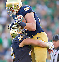 Tight end Troy Niklas (85) celebrates his fourth quarter touchdown with center Nick Martin (72).