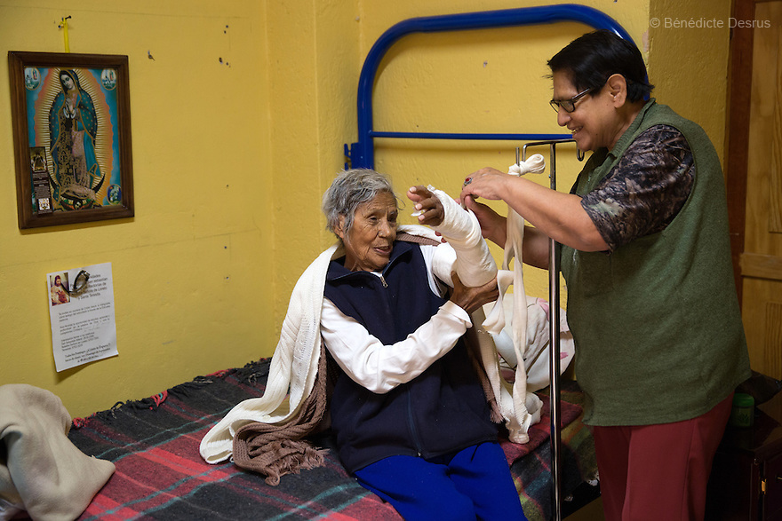 Elia, a resident of Casa Xochiquetzal, takes care of Josée at the shelter in Mexico City, Mexico on February 10, 2017. Casa Xochiquetzal is a shelter for elderly sex workers in Mexico City. It gives the women refuge, food, health services, a space to learn about their human rights and courses to help them rediscover their self-confidence and deal with traumatic aspects of their lives. Casa Xochiquetzal provides a space to age with dignity for a group of vulnerable women who are often invisible to society at large. It is the only such shelter existing in Latin America. Photo by Bénédicte Desrus