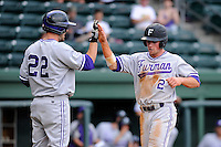 Outfielder Will Muzika (2) of the Furman Paladins, right, is congratulated at home plate by Greg Harrison (22) after scoring on a base hit in a game against the Elon Phoenix in the first round of the Southern Conference Tournament game on Wednesday, May 22, 2013, at Fluor Field at the West End in Greenville, South Carolina. Furman won, 10-1. (Tom Priddy/Four Seam Images)