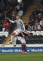 Steven Thompson and Andy webster in the air in the St Mirren v Heart of Midlothian Clydesdale Bank Scottish Premier League match played at St Mirren Park, Paisley on 15.9.12.