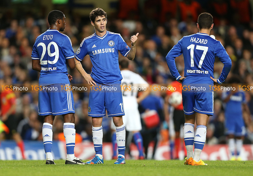 Oscar, Samuel Eto'o and Eden Hazard of Chelsea in discussion - Chelsea vs FC Basel, Champions League Group Stage at Stamford Bridge, Chelsea - 18/09/13 - MANDATORY CREDIT: Rob Newell/TGSPHOTO - Self billing applies where appropriate - 0845 094 6026 - contact@tgsphoto.co.uk - NO UNPAID USE