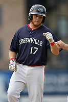 First baseman Garrett Benge (17) of the Greenville Drive is greeted at first base after a single in Game 1 of a doubleheader against the Hickory Crawdads on Wednesday, July 25, 2018, at Fluor Field at the West End in Greenville, South Carolina. Greenville won, 4-1. (Tom Priddy/Four Seam Images)