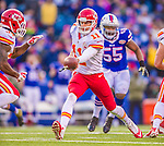 9 November 2014: Kansas City Chiefs quarterback Alex Smith makes a handoff during the fourth quarter against the Buffalo Bills at Ralph Wilson Stadium in Orchard Park, NY. The Chiefs rallied with two fourth quarter touchdowns to defeat the Bills 17-13. Mandatory Credit: Ed Wolfstein Photo *** RAW (NEF) Image File Available ***