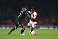 Arsenal's Bukayo Saka and Maksim Medvedev<br /> <br /> Photographer Rob Newell/CameraSport<br /> <br /> UEFA Europa League Group E - Arsenal v FK Qarabag - Thursday 13th December 2018 - Emirates Stadium - London<br />  <br /> World Copyright &copy; 2018 CameraSport. All rights reserved. 43 Linden Ave. Countesthorpe. Leicester. England. LE8 5PG - Tel: +44 (0) 116 277 4147 - admin@camerasport.com - www.camerasport.com